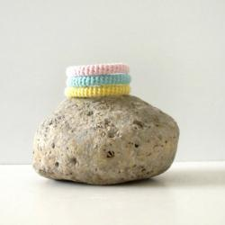 Orbits, crochet bracelet in mint green, yellow and pink.